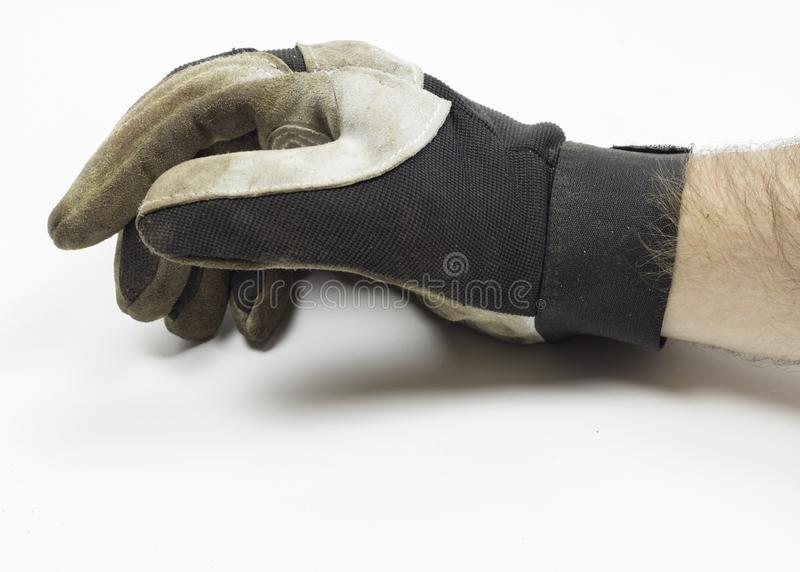 Vuile handschoen met hand en wapen stock foto