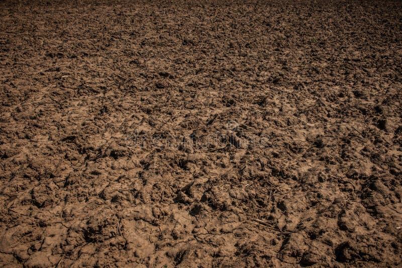 Vuiltextuur De landwegtextuur van het land Onbewerkt land, gebied stock fotografie