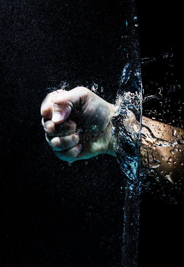 Vuist door water royalty-vrije stock afbeelding