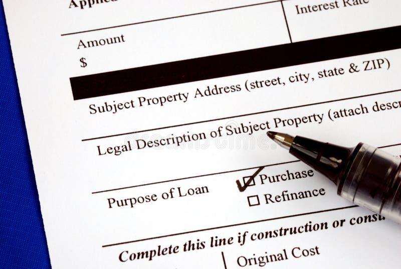 Vul het hypotheekaanvraagformulier in stock foto