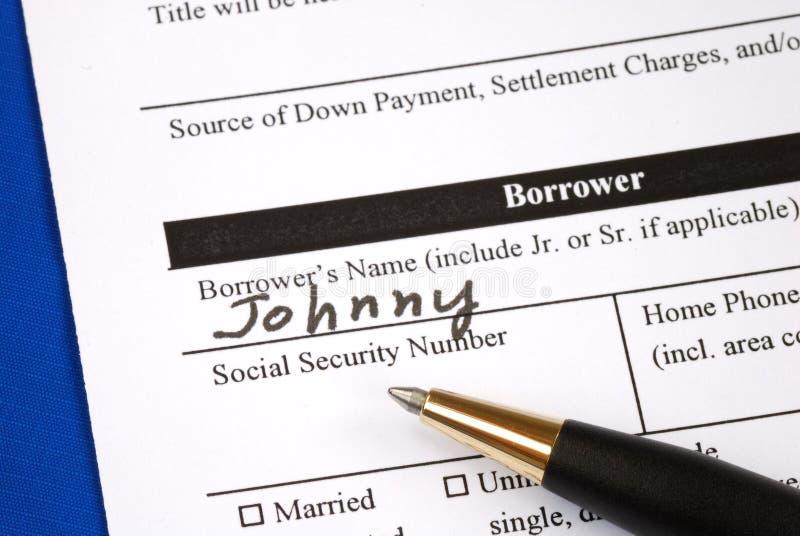 Vul het hypotheekaanvraagformulier in stock afbeeldingen