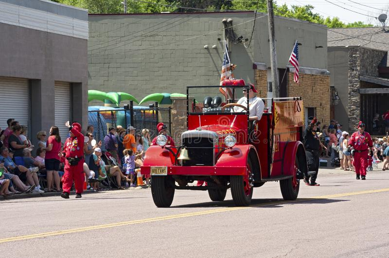 Vulcan Krewe and Motorcade at Mendota Parade. Mendota, Minnesota/USA - July 13, 2019: Vulcan Krewe of Saint Paul Winter Carnival tradition excites spectators as stock photo