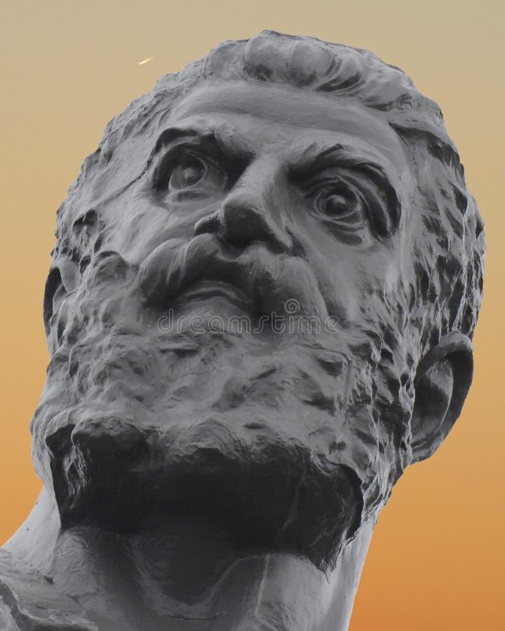 Vulcan, Roman God del fuego y del primer de la puesta del sol de la fragua imagenes de archivo