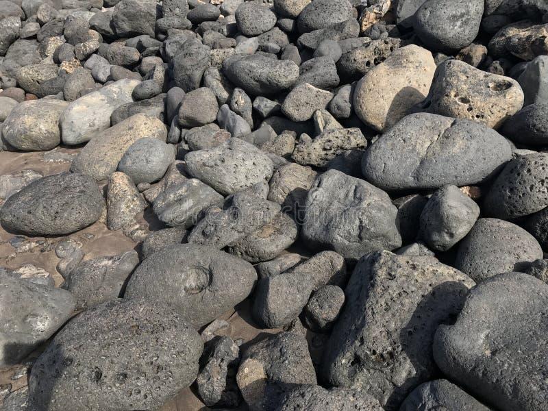 Vulkanische Steine in den verschiedenen Größen stockbild