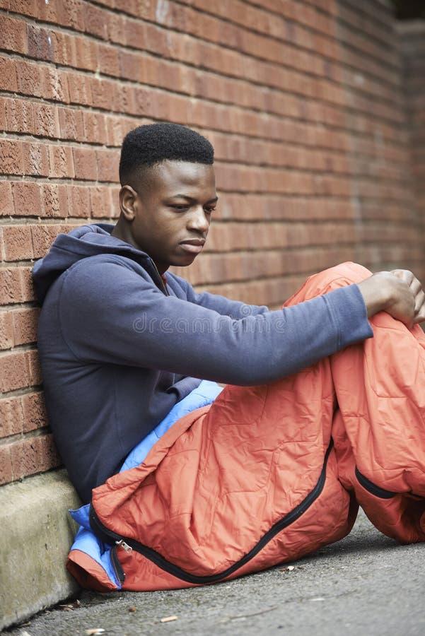 Free Vulnerable Teenage Boy Sleeping On The Street Stock Image - 44406571