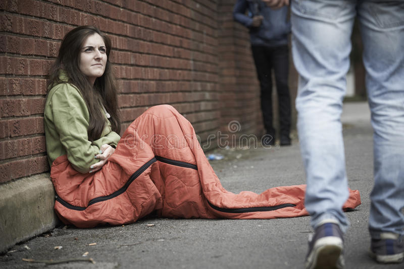 Vulnerable Teenage Girl Sleeping On The Street royalty free stock images