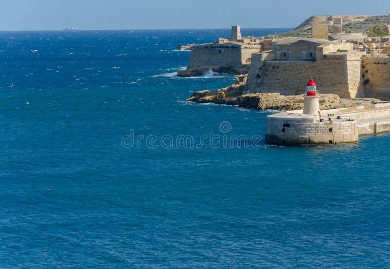 Vuurtoren in Grote Haven, Valletta, Malta stock foto's