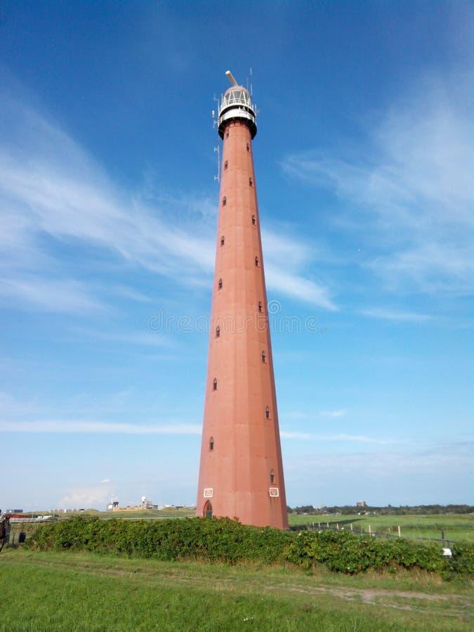 Vuurtoren in Nederland, Den Helder, Noordelijke Overzees stock fotografie
