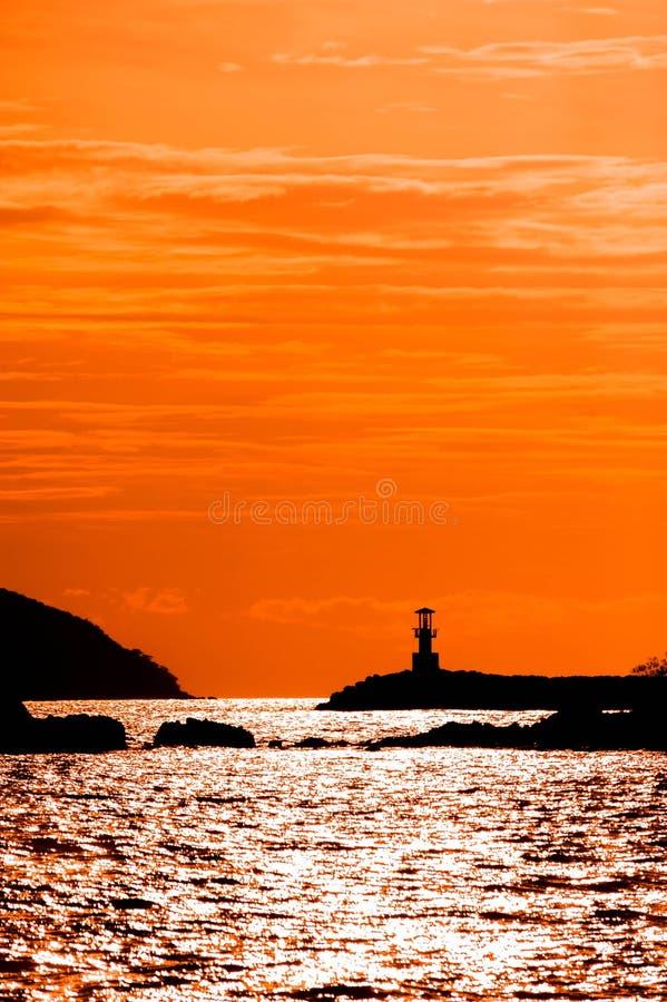 Vuurtoren op zonsondergang royalty-vrije stock foto