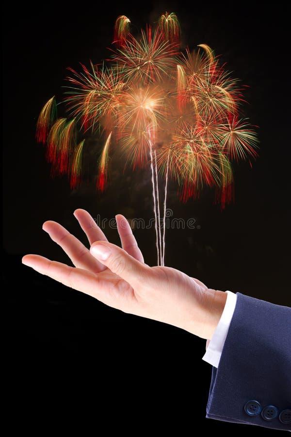 Vuurwerk op hand stock foto