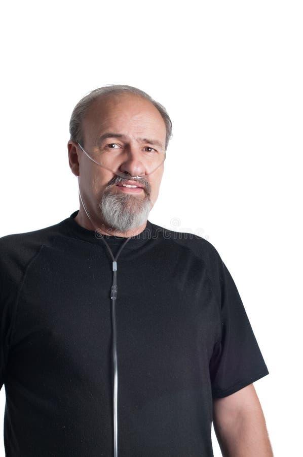 Vuxen man med ett andninghandikapp royaltyfri bild