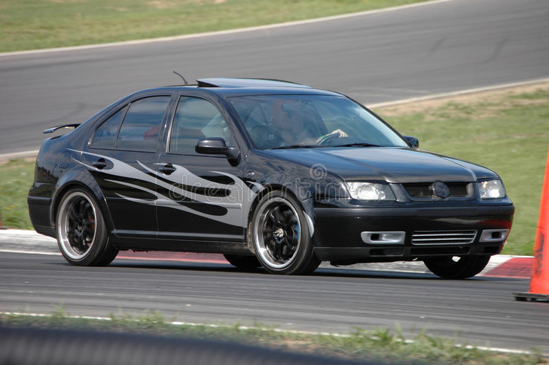 VW Jetta driving on Race Course