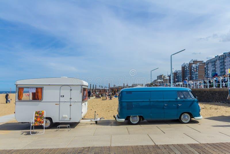 VW kombi camper wagen and caravan trailer at Aircooled classic car show. Scheveningen beach, the Netherlands - May 21, 2017: Blue VW kombi camper wagen and royalty free stock photos