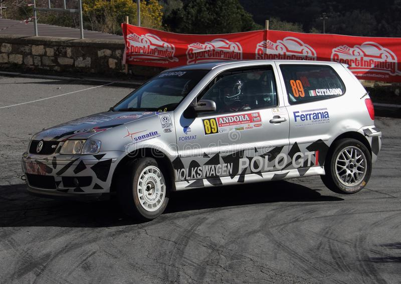 A VW Polo GTI race car involved in the race. During the fifth edition of the `Ronde Della Val Merula` that took place in Italy, in the hinterland of Albenga on royalty free stock image