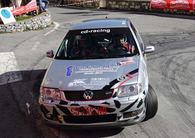 A VW Polo GTI race car involved in the race. During the fifth edition of the `Ronde Della Val Merula` that took place in Italy, in the hinterland of Albenga on stock photo