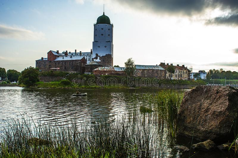Vyborg. Preserved features of the medieval city. St. Olaf`s castle, market square, houses and towers, water and stone ... Greate stock photography