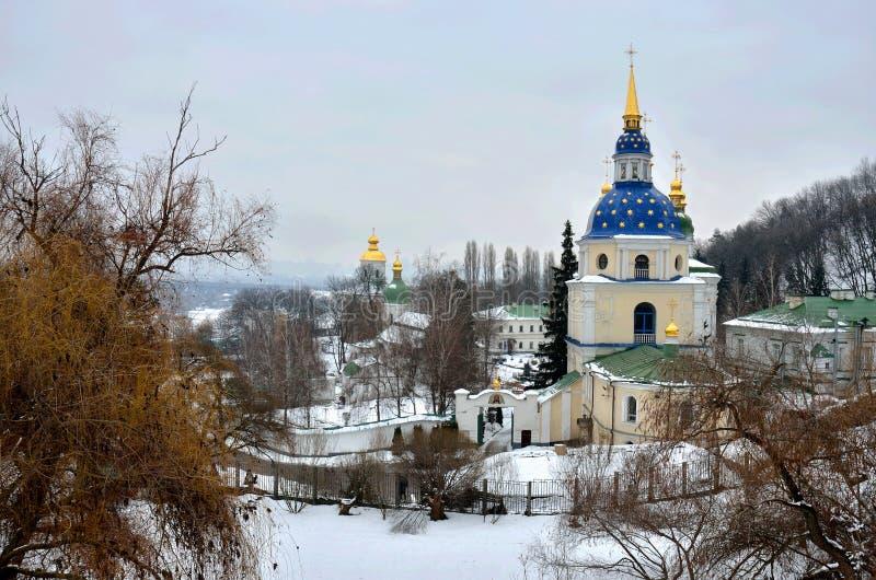 Vydubychi Monastery complex in wintertime, Kyiv, Ukraine,view from Hryshko National Botanical Garden royalty free stock photos