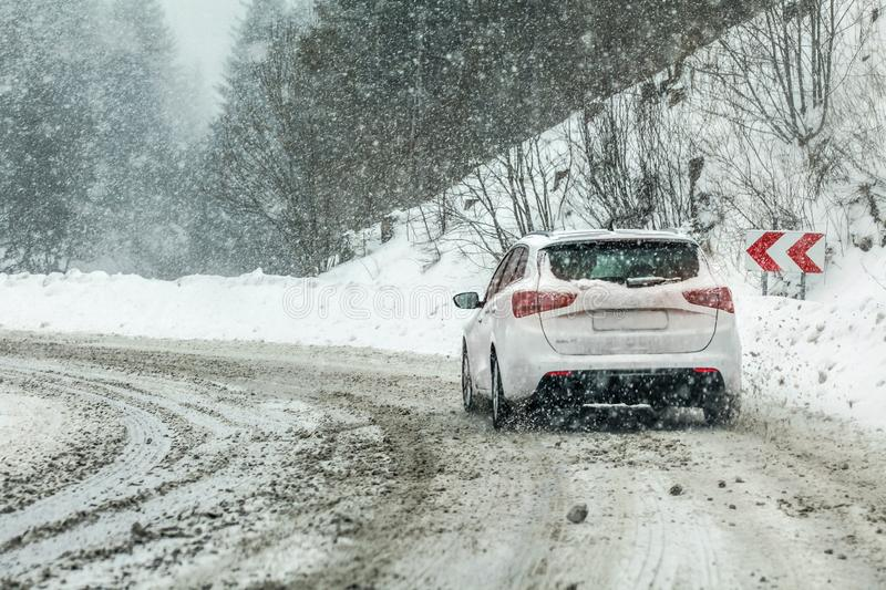 Vysna Boca, Slovakia - January 08, 2019: Car drives through heavy snowstorm on forest road, in sharp curve. Driving conditions are royalty free stock photos