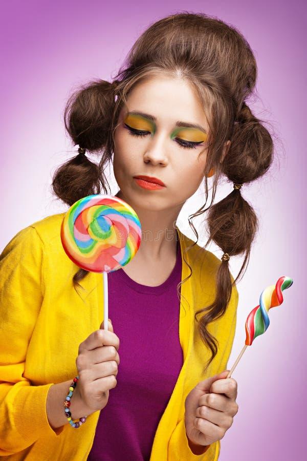 Wählen einer Süßigkeit stockfotografie