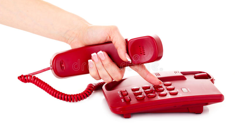 Wählen am roten Telefon stockfotos