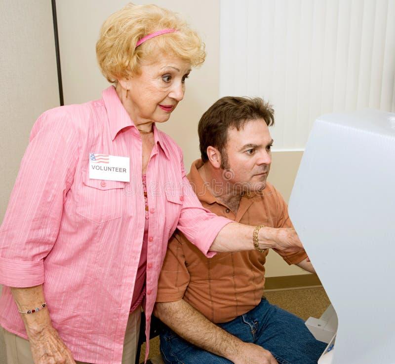 Wählenserie - Hilfe bei der Maschine stockfoto