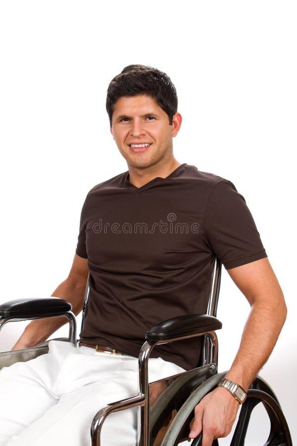Wózek inwalidzki Obezwładniający mężczyzna zdjęcie royalty free