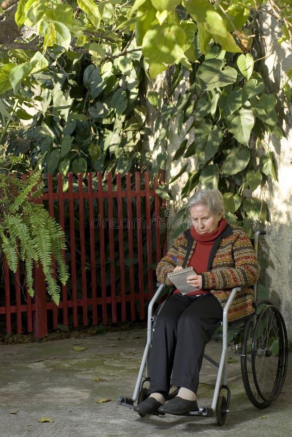 wózek pionowe piśmie kobiety obraz stock