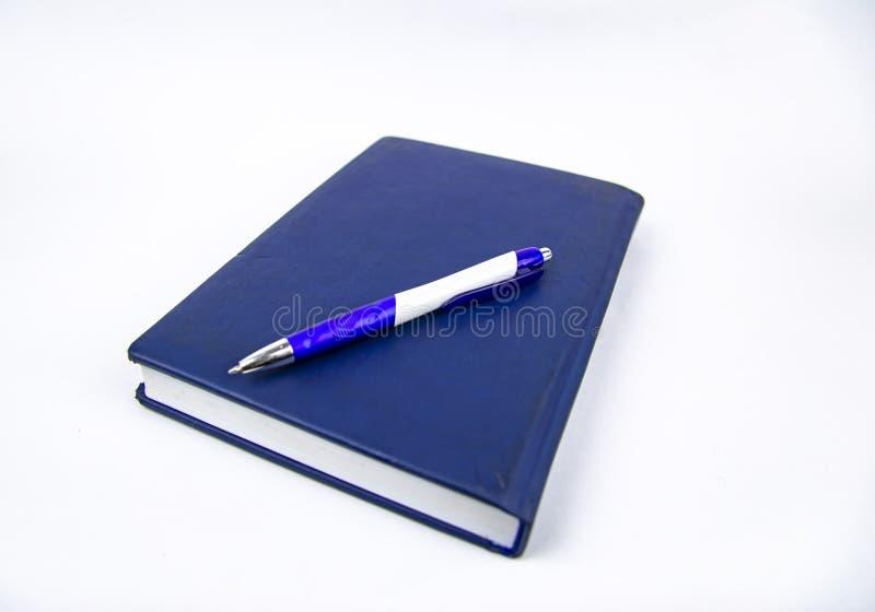 Wöchentlich geschlossen mit Stift auf einem weißen Hintergrund stockfotos