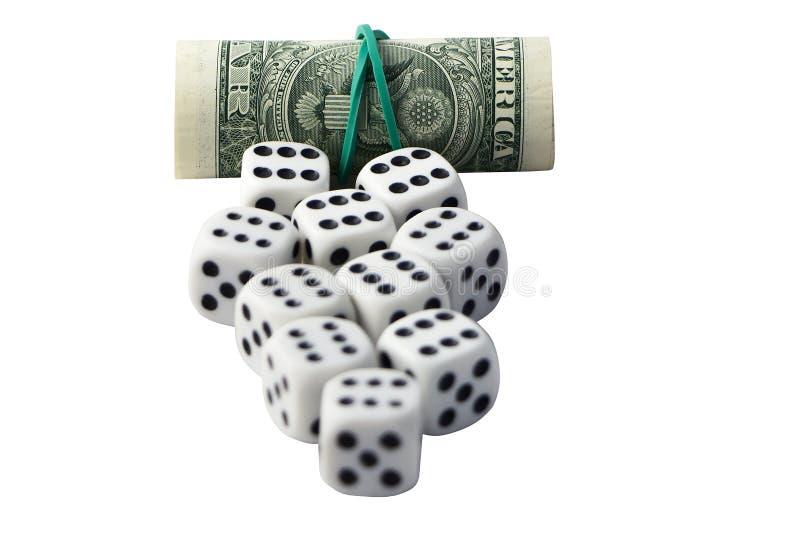 Würfel und Rolle des Geldes lizenzfreies stockbild