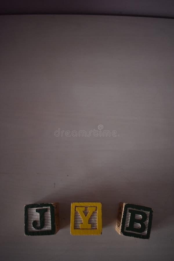 Würfel von Buchstaben stockbild