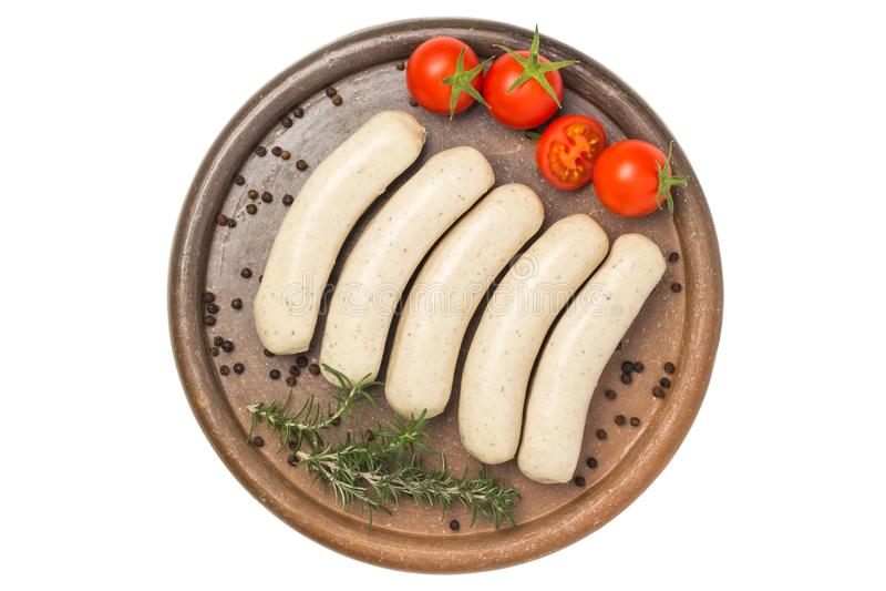 Würste mit Tomate, Rosmarin und schwarzem Pfeffer stockbilder