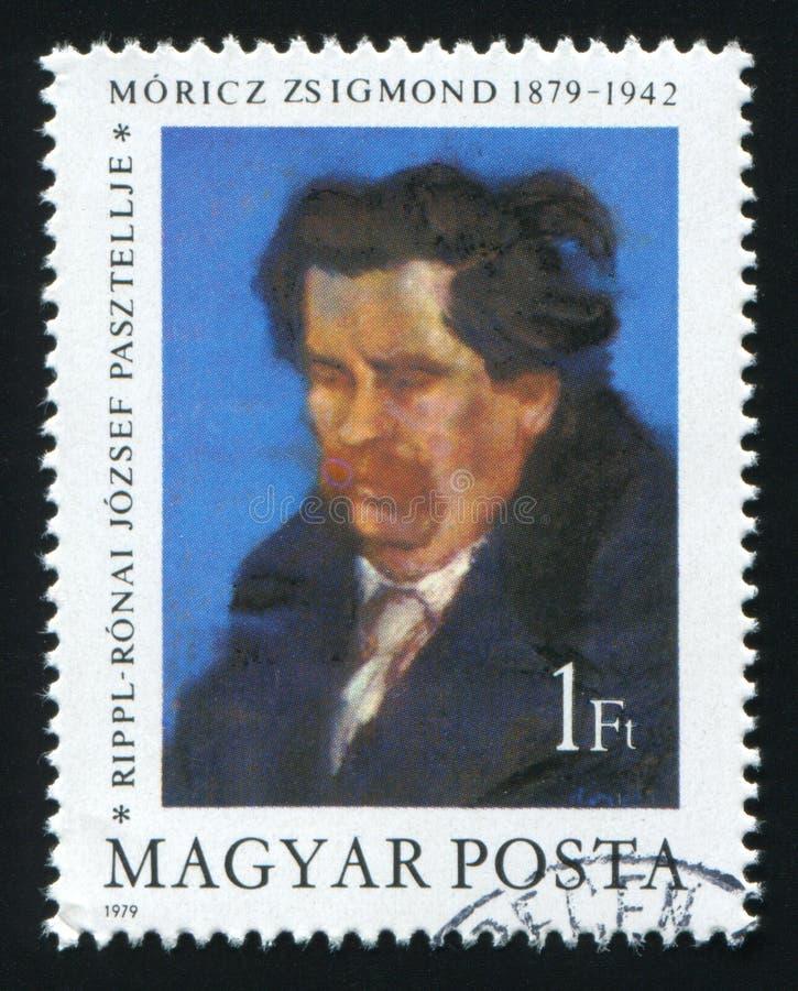 WĘGRY - OKOŁO 1979: Poczta znaczek drukujący w Węgry pokazuje obraz Zsigmond Moricz Jozsef czochrą około 1979, obraz stock