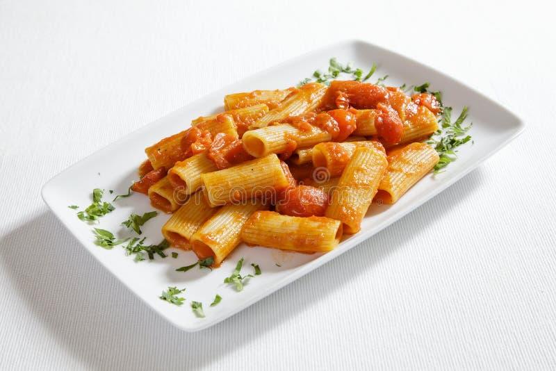 Włoski makaron z pomidorowym kumberlandem zdjęcie stock