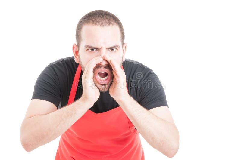 Wściekły hypermarket sprzedawca krzyczy out głośnego obraz royalty free