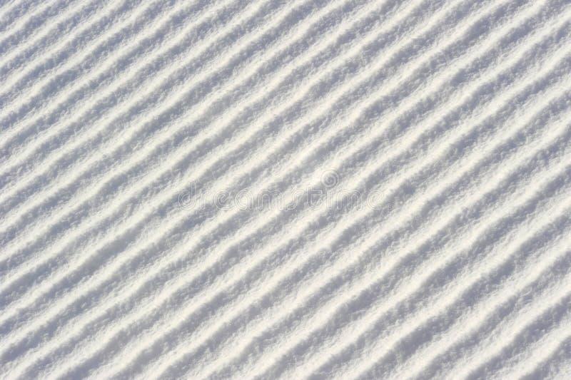 Przekątna macha w śniegu (lub granie) obraz royalty free