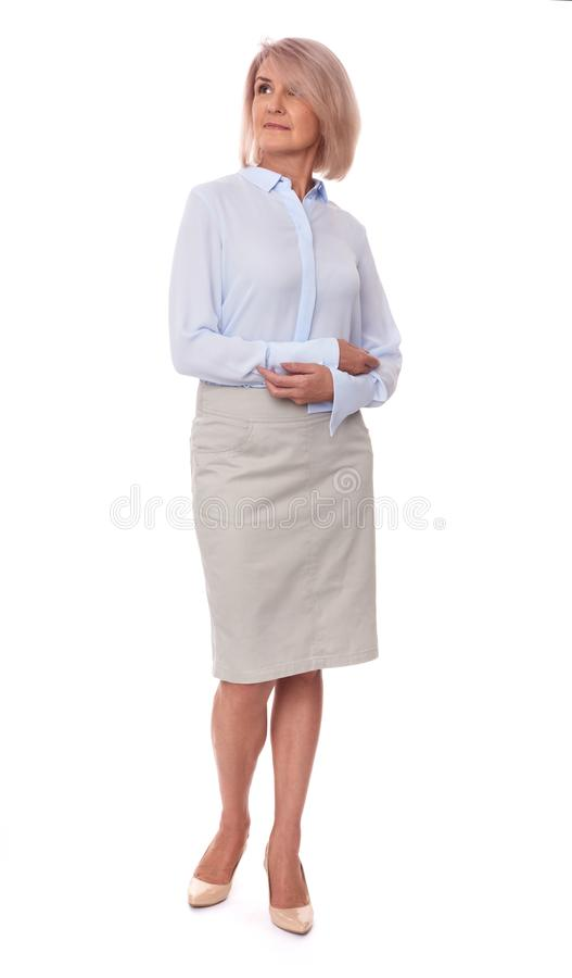 W średnim wieku biznesowa kobieta na bielu zdjęcie royalty free
