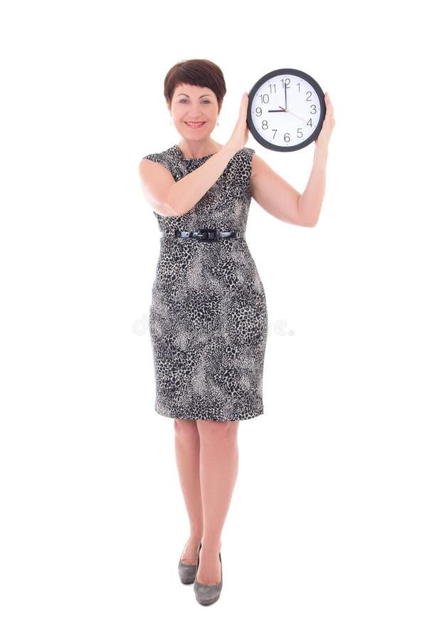 W średnim wieku bizneswomanu mienia zegar obrazy stock