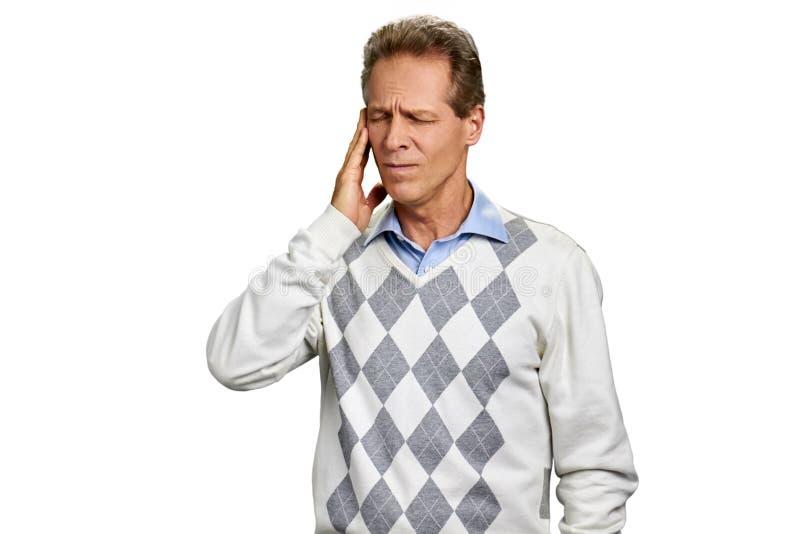 W średnim wieku mężczyzna cierpienie od migreny zdjęcie stock