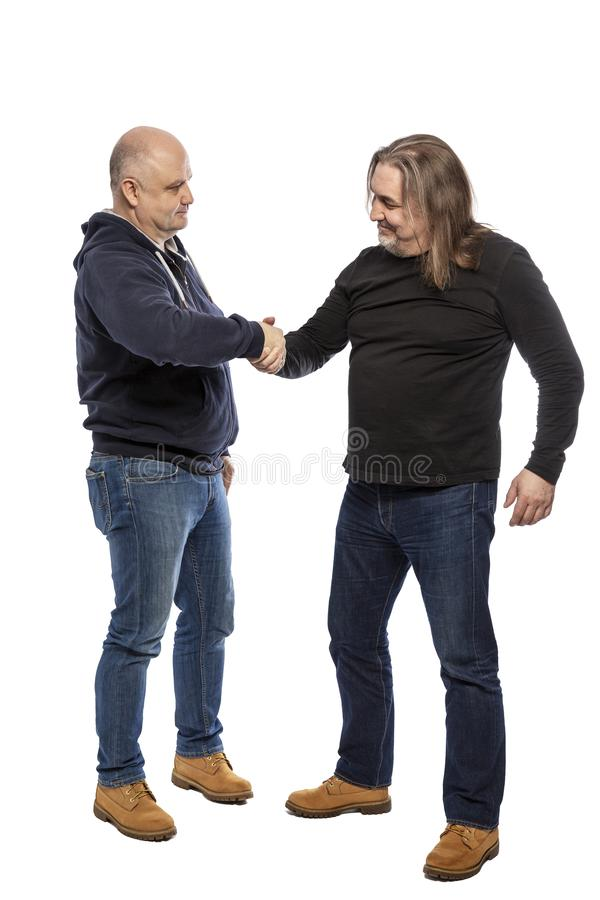 W średnim wieku mężczyzny potrząśnięcia ręka, pełna długość pojedynczy białe tło obraz royalty free