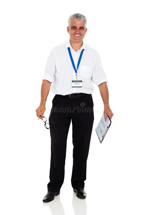 W średnim wieku napędowy instruktor zdjęcie royalty free