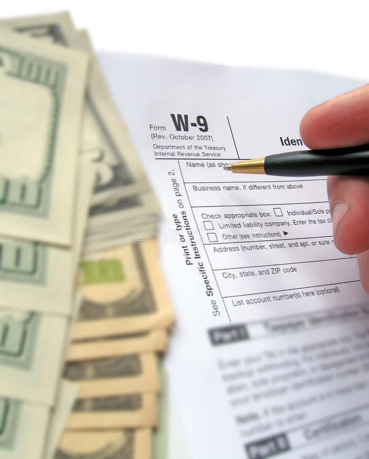 w-9 revenue tax form filling, black pen, savings royalty free stock image