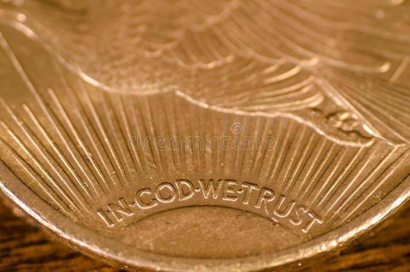 W bóg Ufamy na USA Złocistej monety świętym (słowa) zdjęcia royalty free