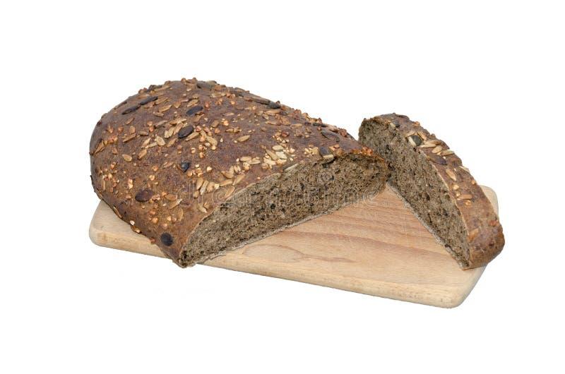 W biały tle całka chleb zdjęcie stock