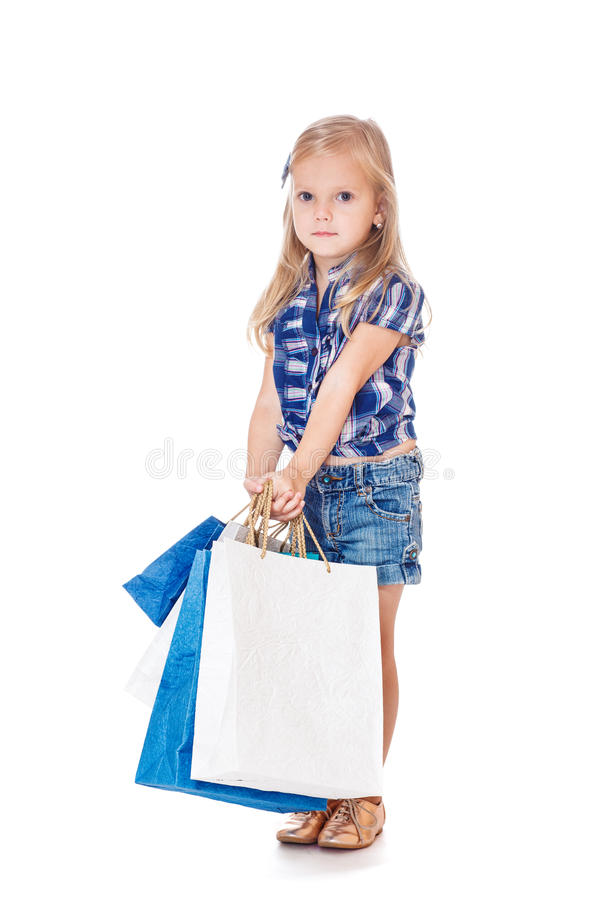 W drelichowej odzieży mały kupujący zdjęcie royalty free