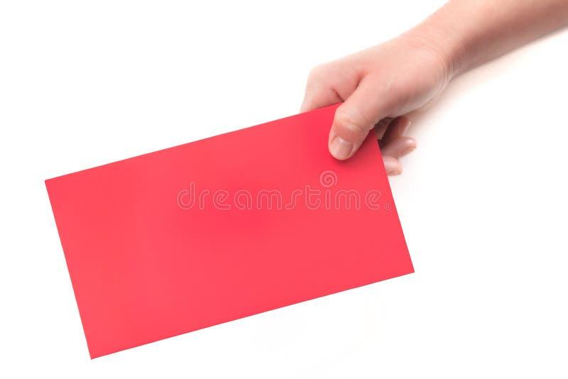 A w górę czerwonej kopertowej czerwonej kartki w białym tle w jeden ręce fotografia royalty free