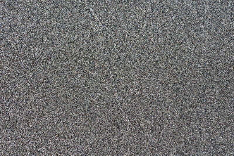 W górę makro- widoku piaska czerni powulkanicznego koloru Szczeg??owa natura wzoru tekstura zdjęcia stock