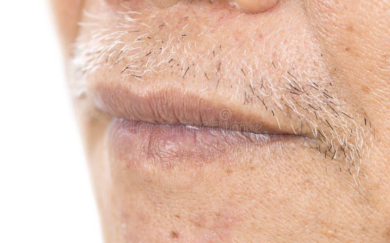 W górę starszego azjatykciego mężczyzny usta z zmarszczeniem na twarzy obrazy stock
