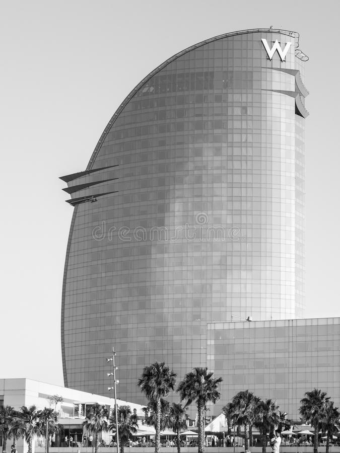 The W Hotel. BARCELONA, SPAIN - JULY 12, 2015: W Hotel (Called Hotel Vela) designed by architect Ricardo Bofill. Picture taken from the Barceloneta beach in a stock photography