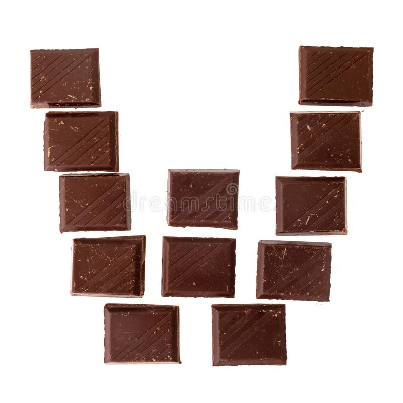 Isolate chocolate letter, alphabet. W- Isolate chocolate letter, alphabet on white background stock image