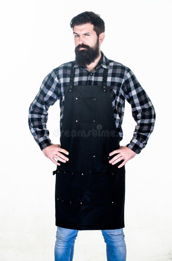 W klasycznym czerni Grilla kucharz odizolowywaj?cy na bielu Cook z d?ug? brod? jest ubranym ?liniaczka fartucha Mistrzowski kucha obrazy stock